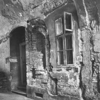 No. 24 Úri street, the stone frame of a medieval door opening and the ramains of a sitting niche in the southern wall if the gateway, 1961