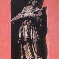 The statue of Saint John of Nepomuk in a wall niche in the Buda Castle in Bécsi Gates square